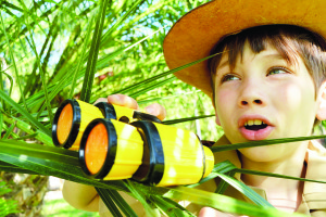 When Kids Unplug Interesting Things Happen (photo of a boy discovering something with binoculars)
